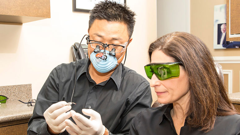 Dr. Michael Chung works on a patient at Softouch Dental Care in Virginia