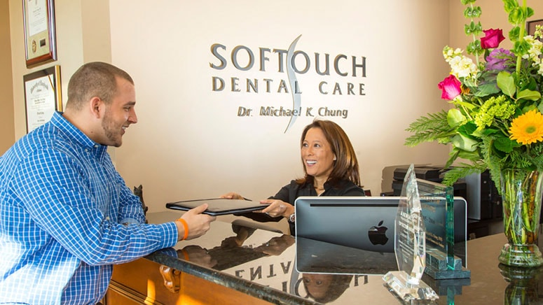 Softouch Dental Care staff greets a patient at their office in Virginia