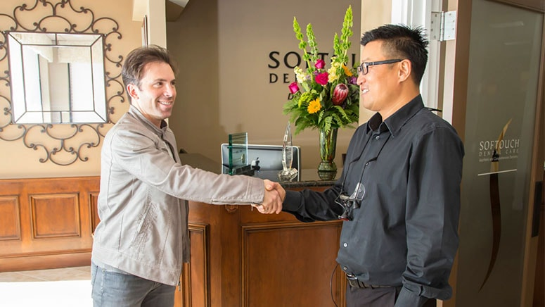 Dr. Michael Chung greets figure skater Michael Weiss at his dental office in Virginia
