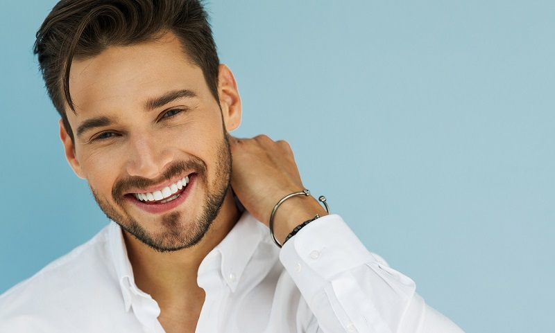 Man with porcelain veneers from Softouch Dental Care